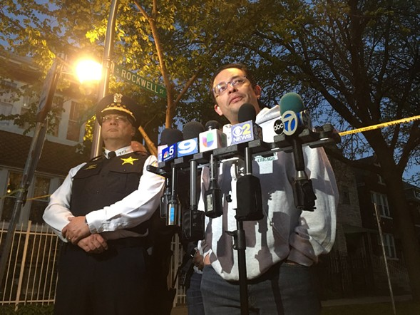 Chicago Police Department deputy superintendent Kevin Navarro and 15th Ward alderman Raymond Lopez speak at a press conference Sunday night. - LAUREN FITZPATRICK/SUN-TIMES