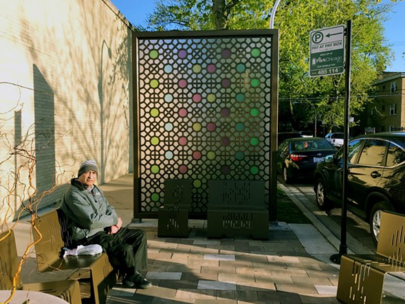 "A seating area off Devon with a ""gateway screen"" inspired by Islamic architecture. - JOHN GREENFIELD"