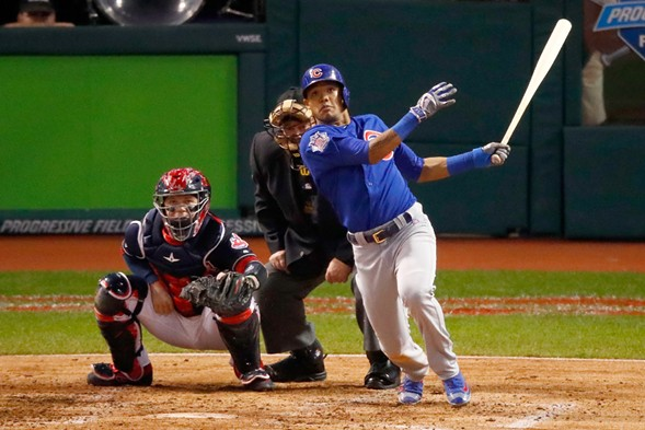 Addison Russell hits a grand slam in game six of the 2016 World Series. - GREGORY SHAMUS/GETTY IMAGES