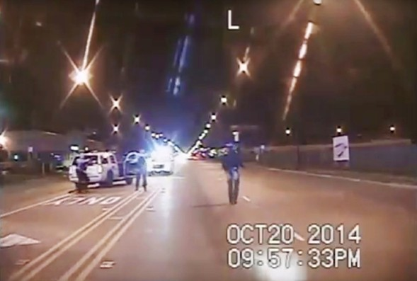 In this file image from October 20, 2014, taken from dash-cam video provided by the Chicago Police Department, Laquan McDonald, right, walks down the street moments before being fatally shot by Chicago Police officer Jason Van Dyke. - CHICAGO POLICE DEPARTMENT VIA AP, FILE