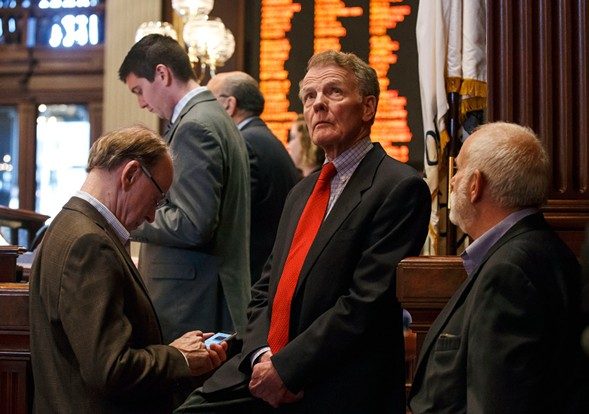 Illinois speaker of the house Michael Madigan looks up toward the video boards during an overtime session at the state capitol Sunday. The Illinois House has approved an income tax increase as part of a plan to end the nation's longest budget standoff.