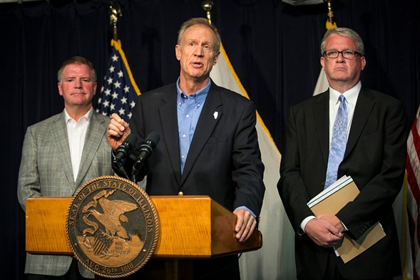 Flanked by state senate GOP leader Bill Brady, left, and Illinois house minority leader Jim Durkin, Governor Bruce Rauner discusses school funding during a news conference in Chicago on Monday. - ASHLEE REZIN/CHICAGO SUN-TIMES VIA AP