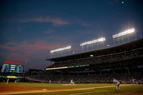 The Chicago Cubs play the Saint Louis Cardinals during a night game at Wrigley Field. - PHOTO BY JON DURR/GETTY IMAGES