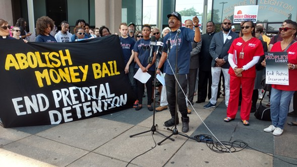 Bail reform advocates rally in front of the Leighton Criminal Courthouse on Monday before the first day of bond court under new orders - MAYA DUKMASOVA