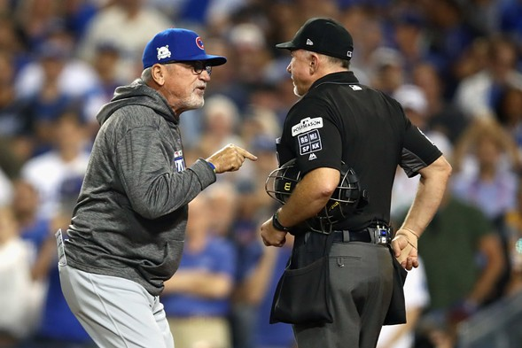 Joe Maddon  argues a call with an umpire during the National League Championship Series game against the Los Angeles Dodgers at Dodger Stadium Saturday. - PHOTO BY EZRA SHAW/GETTY IMAGES