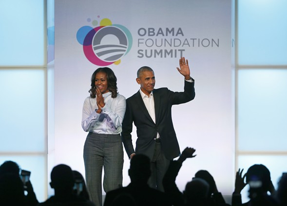 Former president Barack Obama and former first lady Michelle Obama arrive for the first session of the Obama Foundation Summit Tuesday. - AP PHOTO/CHARLES REX ARBOGAST