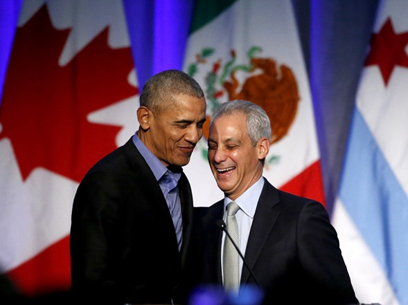 Former president Barack Obama and Mayor Rahm Emanuel share a laugh at Chicago's recent summit on climate change. - AP PHOTO/CHARLES REX ARBOGAST