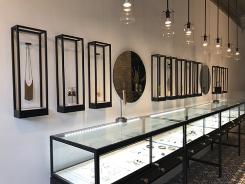 Vitrines display the wares at Logan Square's Adornment + Theory. - ISA GIALLORENZO