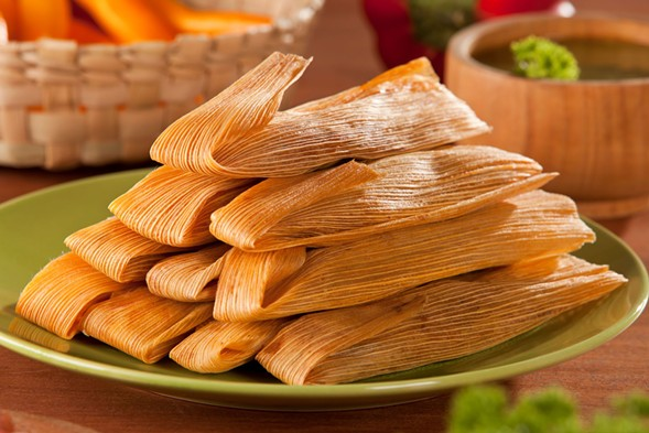 Stack tamales in your stomach at the Delta's Eat More Tamales event - on Monday 1/8. - GETTY IMAGES