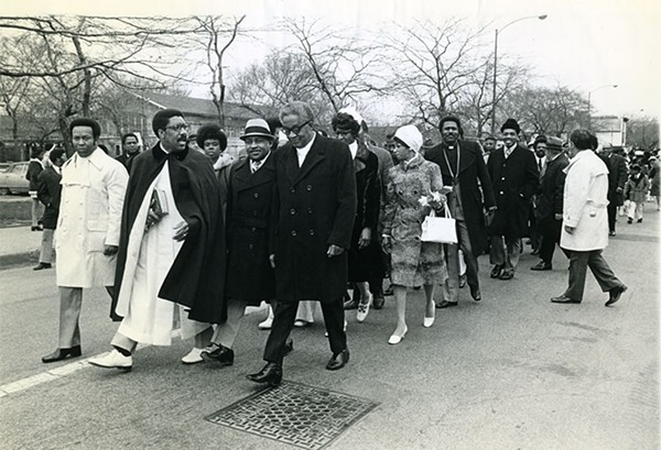 The Reverend Clay Evans (at left, in white shoes) leads members to the Fellowship Missionary Baptist Church's new building for its opening day on April 8, 1973. - COURTESY CHICAGO PUBLIC LIBRARY