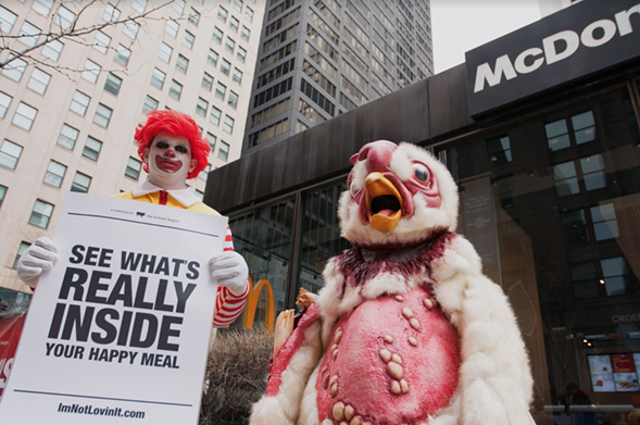 Demonstrators protested outside a McDonald's in the South Loop on Wednesday.