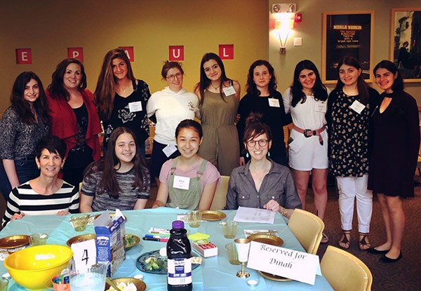 The RTI interns with DePaul and JUF faculty at the first-ever anti-rape culture seder last May at DePaul University. - COURTESY STEPHANIE GOLDFARB