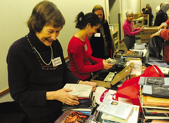 Volunteers at the Evanston Public Library book sale in 2011 - RYAN PAGELOW