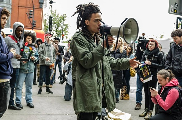 Ethan Viets-VanLear leads a demonstration in front of the Walgreens where Dominique Franklin Jr. was fatally tased by CPD officers in 2014. - SARAH-JI/LOVE AND STRUGGLE PHOTOS.