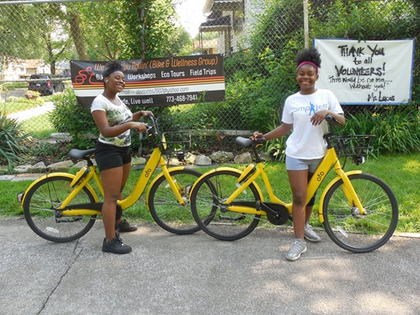 Kids use Ofo bikes from We Keep You Rollin's bike library during a recent group ride. - WE KEEP YOU ROLLIN'