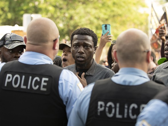 Police and protesters confront one another the day after the shooting of Harith Augustus on July 15. - COLIN BOYLE/SUN-TIMES
