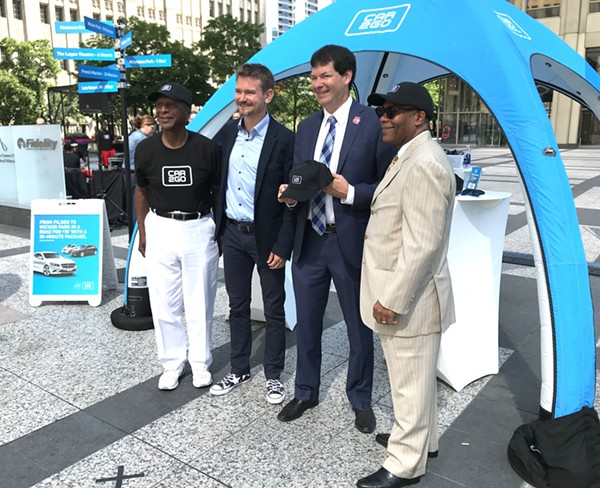 Illinois secretary of state Jesse White, Car2go CEO Olivier Reppert, and aldermen Brian Hopkins and Walter Burnett. - JOHN GREENFIELD