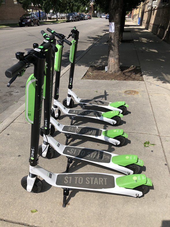Lime demoed some of its e-scooters in Pilsen near Fiesta Del Sol over the weekend. - RYAN SMITH