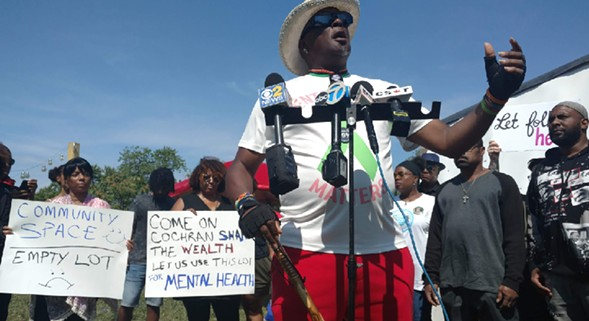 "Mental Health Movement organizer Ronald Jackson decried alderman Willie Cochran's plan to remove the ""Healing Village"" from an empty lot in Woodlawn. - MAYA DUKMASOVA"
