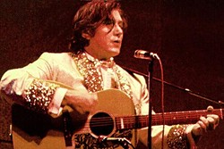 Phil Ochs in his Elvis suit. - YOUTUBE