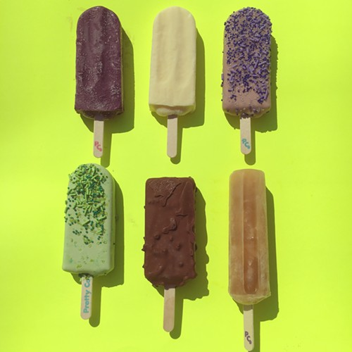 Clockwise from upper left: blackberry-buttermilk, lemon-buttermilk,  grape party pop, Arnold Palmer truck pop, coffee-pretzel-toffee-custard bar, green apple party pop - MIKE SULA