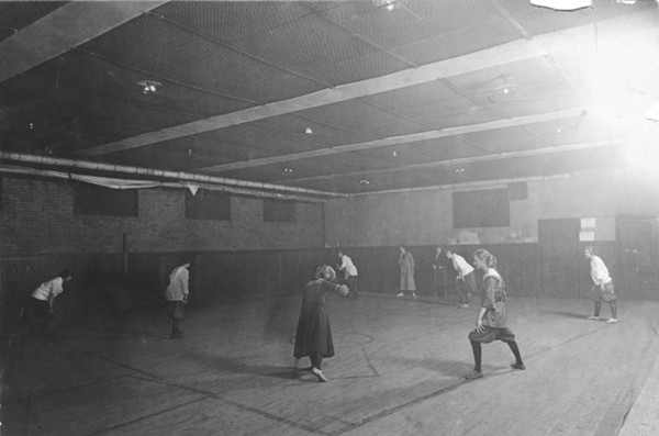 Young women playing indoor baseball in Pilsen - BHNC_0044_0290_026, UNIVERSITY OF ILLINOIS AT CHICAGO LIBRARY, SPECIAL COLLECTIONS