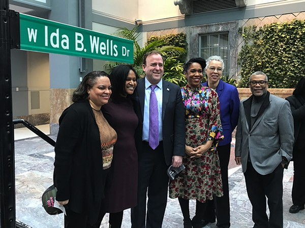 Michelle Duster, great-granddaughter of Ida B. Wells; Aldermen Sophia King and Brendan Reilly; Illinois lieutenant governor Juliana Stratton; Cook County Board president and mayoral candidate Toni Preckwinkle; and Alderman Walter Burnett (27th) at the sign unveiling at the Harold Washington Library Center's Winter Garden - JOHN GREENFIELD
