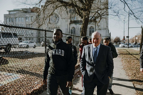 Bill Daley with Reverend Marshall Hatch and members of the MAAFA Redemption Project at New Mount Pilgrim Missionary Baptist Church in West Garfield Park - CHRIS COSTOSO