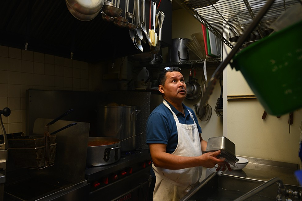 Benjamin does dishes in the back of the kitchen; he worked various roles in both the front and back of the house of other restaurants before opening Buena Vista in 2004. - GONZALO GUZMAN