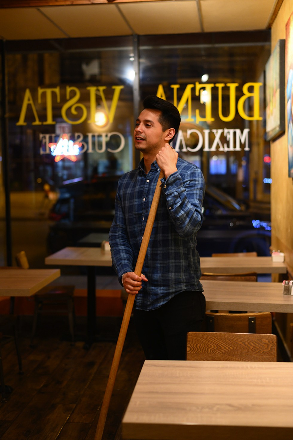 Edwin Ramirez, 25, cleans up after a busy dinner service. He started working at the restaurant in high school and gained an appreciation for the family business in college. - GONZALO GUZMAN