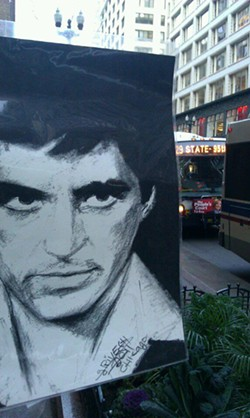 A portrait of Tony Montana in Scarface is part of a display for the artist zebra at State and Madison. - DANIEL X. O'NEIL