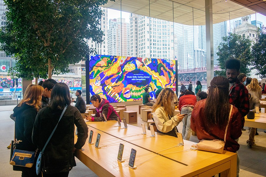 The Forum of the Michigan Avenue Apple Store, with its video wall and movable wooden box seating, hosts many Today at Apple events. - MARK BRABOY