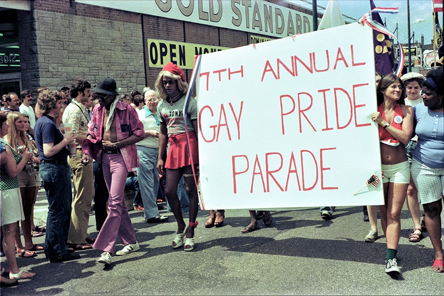 "A handmade sign proclaims the - ""7th Annual Gay Pride Parade."" - DIANE ALEXANDER WHITE"
