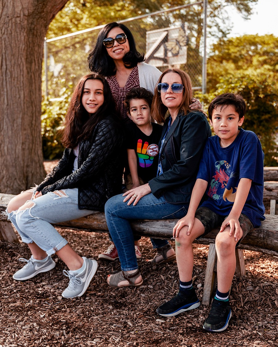 Mercedes Santos and Theresa Volpe with their children Jaidon (11), Lennox (five), and Ava (14) .  Santos and Volpe were one of the first legally wed gay couples in Illinois. - RYAN EDMUND