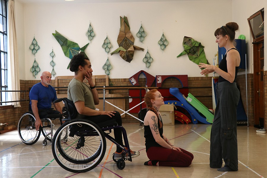 "Lenzo instructs Robby Williams in a duet at the Academy of Movement and Music in Oak Park. Williams, a former tango dancer, lost his lower-body functions in 2018 from gun violence. Lenzo helps him to gain more mobility on the wheel chair. ""I look forward to being a resource for him,"" said Lenzo. - CAROLYN CHEN"
