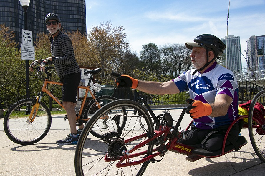 Lenzo and his brother, Steve, hand-cycle from Oak Park to Navy Pier. Lenzo usually handcycles about 20 miles twice a month with Steve. - CAROLYN CHEN