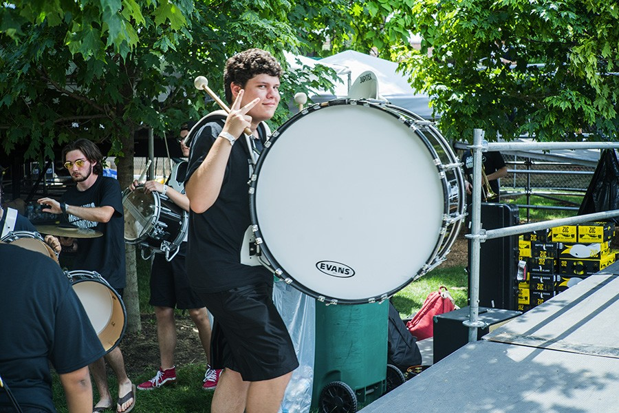 A marching band drummer heads to stage. Wilson brought out the graduating senior class of Lane Tech to preform an unreleased song. - TIM NAGLE
