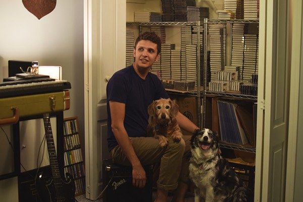 """Matthew Sage in the Patient Sounds """"office"""" with his dogs, Molly and Phoebe. He throws a farewell party for the label on Wednesday, August 21. - LYNETTE SAGE"""