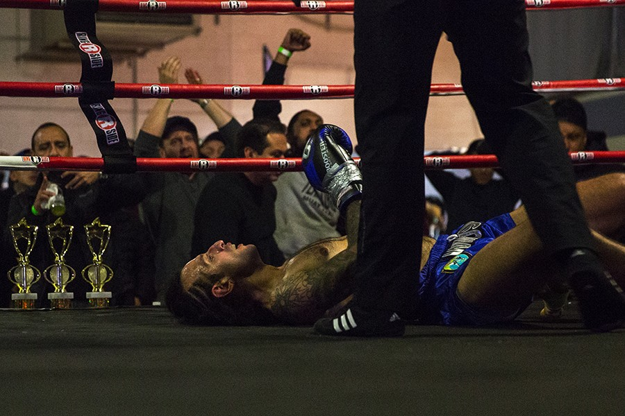 Evaristo Hernandez stares up at the ceiling after being knocked out in his co-main event fight on Saturday, February 2, 2019, at Chi-Town Football in Chicago. - GEOFF STELLFOX