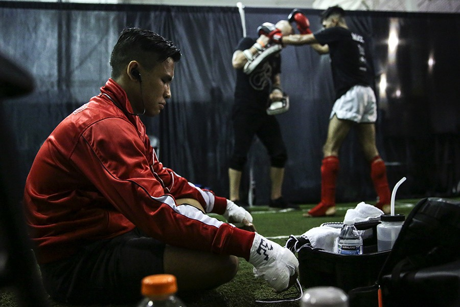 Fighter Jimmy Do meditates before his headlining bout on Saturday, July 27, 2019, at Prime Muay Thai in Bolingbrook. - GEOFF STELLFOX