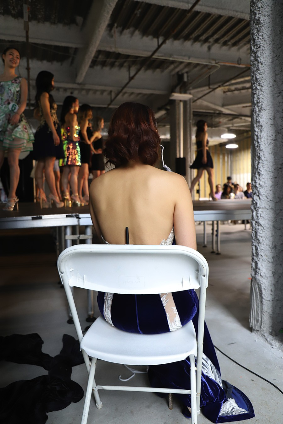 Ng watches the contestants promenade during the pageant. - CAROLYN CHEN