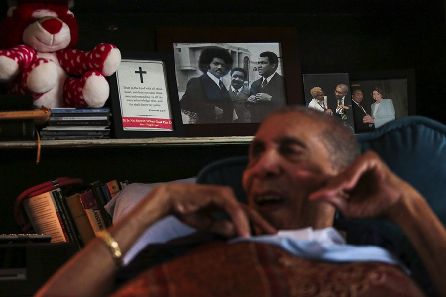 Behind Clay's head is a photo of him with the Reverend Jesse Jackson and Muhammad Ali. - GEOFF STELLFOX FOR CHICAGO READER