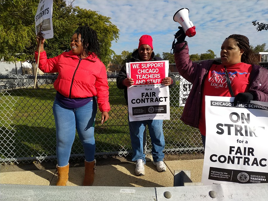 Picketing teachers solicited horn honks from passing cars on 71st Street in Englewood. - MAYA DUKMASOVA FOR CHICAGO READER