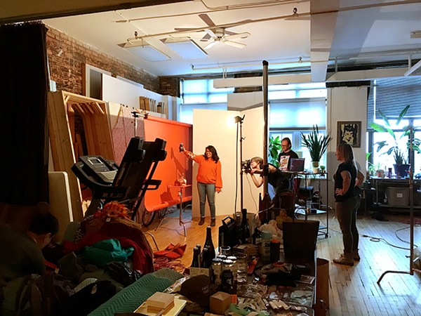 Yazmin poses for the Arts & Culture shoot. Lisa sets up the shot with help from Jamie Ramsay and photo assistant Brian Gladkowski. - LENI MANAA-HOPPENWORTH FOR CHICAGO READER