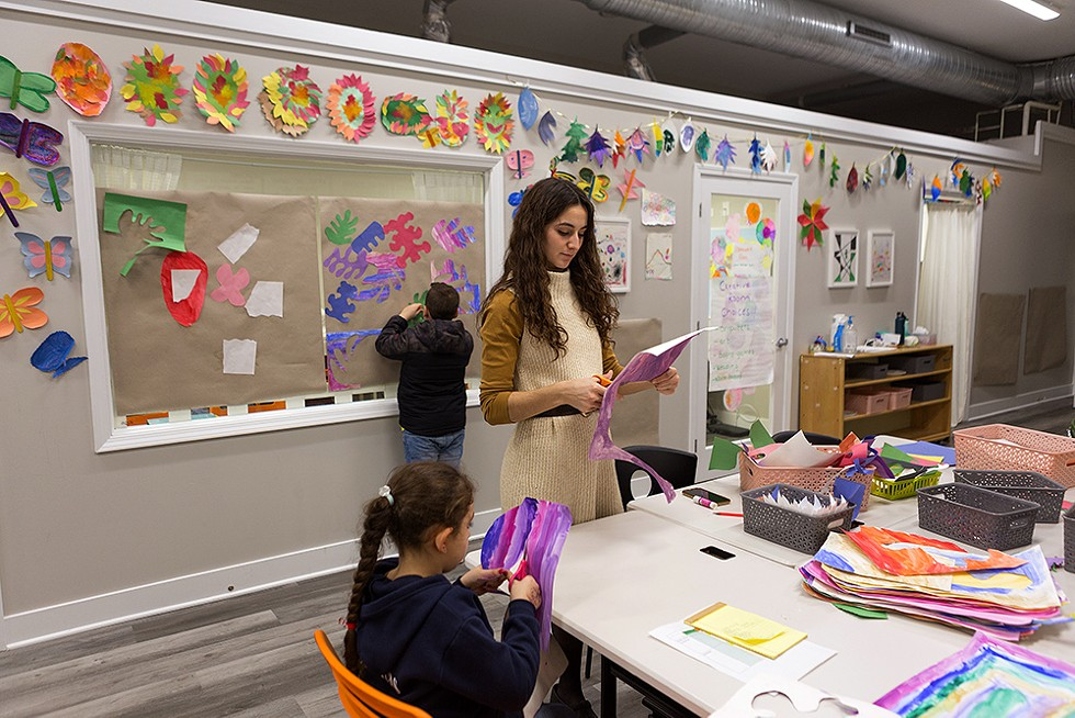Ms. Amanda leads an art activity that guided the children through exploring ethnicities and origins. - FARAH SALEM FOR CHICAGO READER