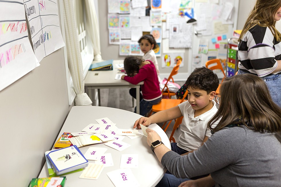 Ayoub, 7, studies English grammar in the homework tutoring room. Ayoub and his family moved to Chicago from Syria about three years ago. - FARAH SALEM FOR CHICAGO READER