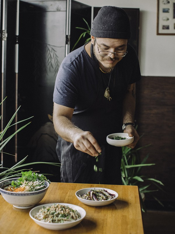 Eric Wat dresses some of Lao Peng You's non-dumpling dishes, which include cold steamed eggplant, cold noodles, and vegetarian noodle soup. - JEFF MARINI FOR CHICAGO READER