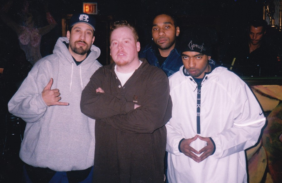 """Jesse de la Peña (second from left) at Blue Groove with members B-Real (far left) and Eric Bobo (far right) of Cypress Hill. Chicago DJ Uncle Milty is second from right. This was at Funky Buddha Lounge, probably in the early 2000s. - """"BIG LARRY"""" MONDRAGON"""