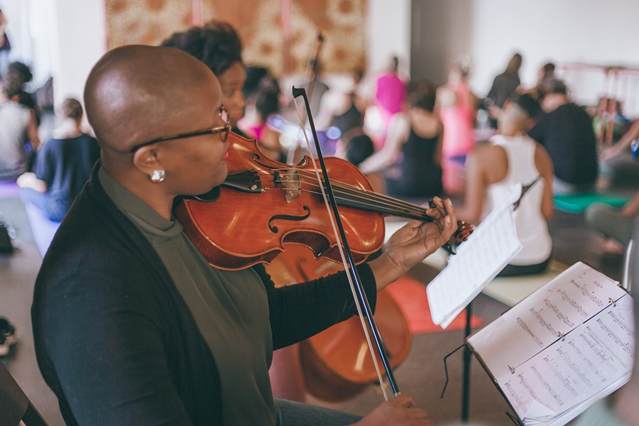 D-Composed artistic director and violist Danielle Taylor plays with the quartet at a D-Compressed yoga concert. - ALLY ALMORE