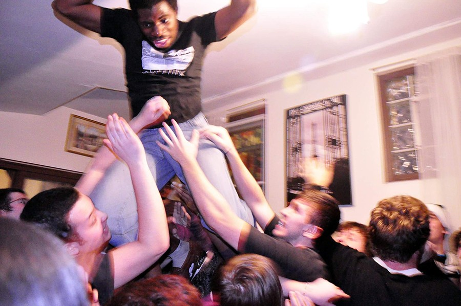 Nnamdï enjoys the support of the crowd during a 2011 show in his family's home, aka Nnamdi's Pancake Haus. - COURTESY NNAMDÏ